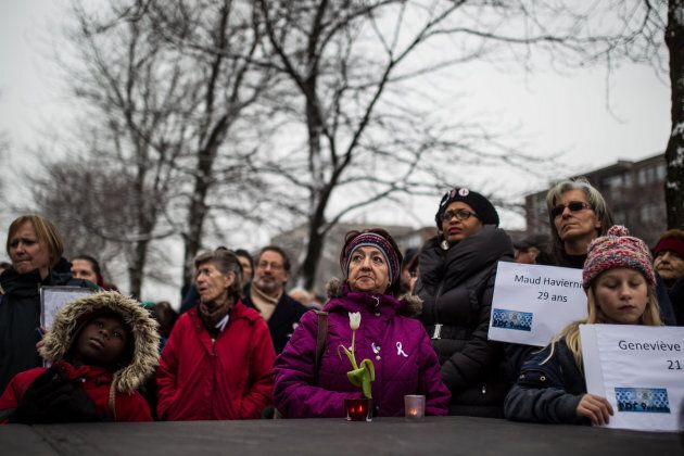 People take part in a ceremony to mark the anniversary of the Polytechnique massacre in Montreal on Dec. 6, 2014.