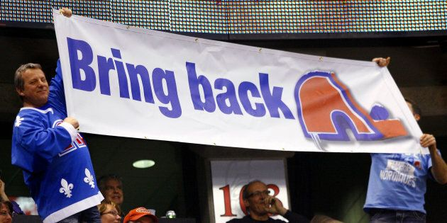 A Quebec Nordiques fan shows his support for their return to the NHL at a game between the Calgary Flames...