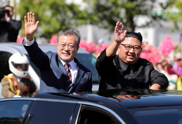 South Korean President Moon Jae-in and Kim Jong Un ride in Pyongyang, North Korea. Sept. 18,