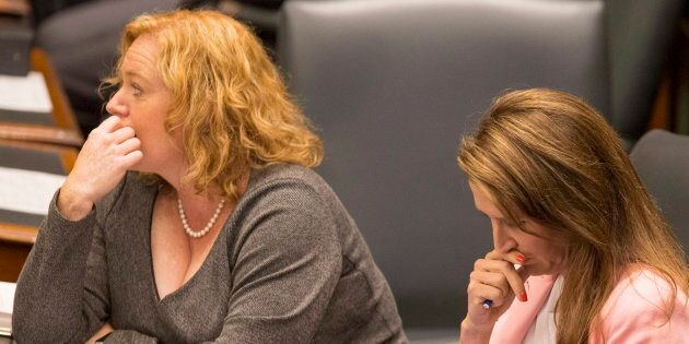 Ontario ministers Lisa MacLeod and Caroline Mulroney sit at Queen's Park in Toronto on Sept. 12, 2018. The auditor general says that Legal Aid Ontario spends $20 million a year appealing the decisions of the Ontario Disability Support Program (ODSP).