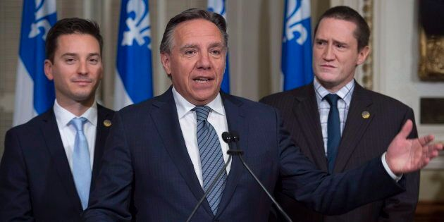 In this Oct. 19, 2016, photo, Quebec Premier Francois Legault, then the leader of CAQ, is flanked by MNAs Simon Jolin-Barrette, left, and Benoit Charrette at a news conference at the legislature in Quebec City.