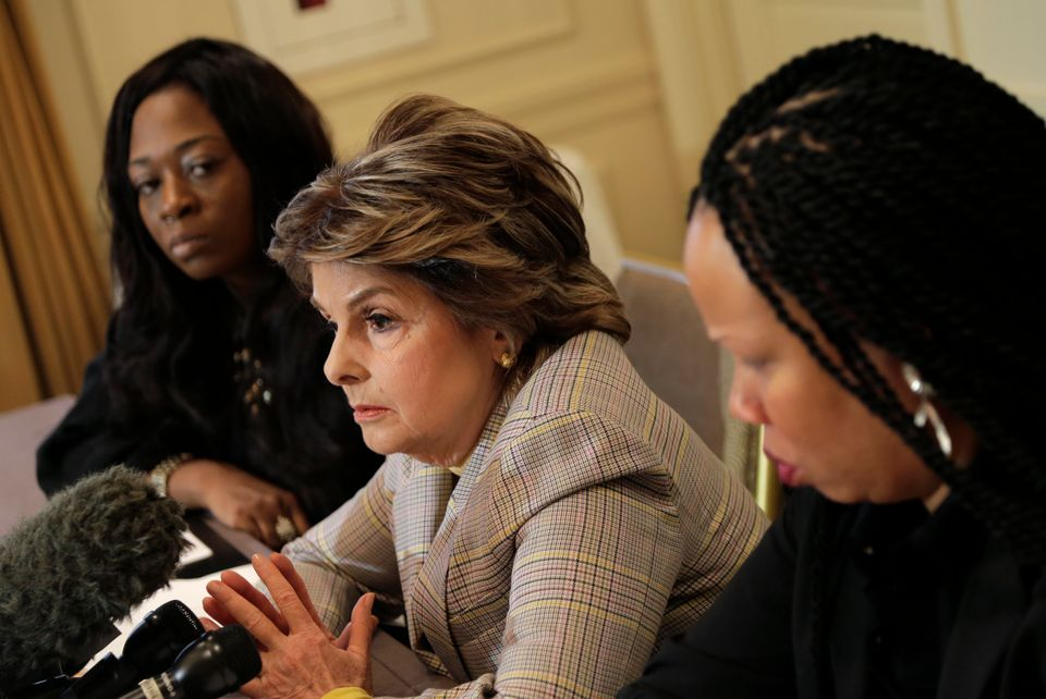 Attorney Gloria Allred, center, speaks while Latresa Scaff, right, and Rochelle Washington look on during...