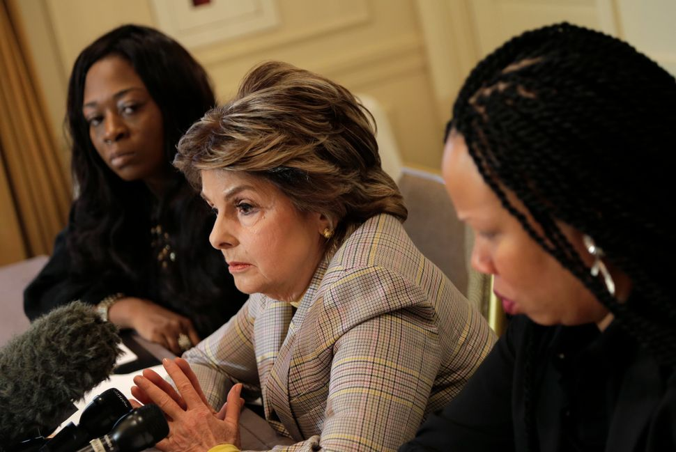 Attorney Gloria Allred, center, speaks while Latresa Scaff, right, and Rochelle Washington look on during a news conference.