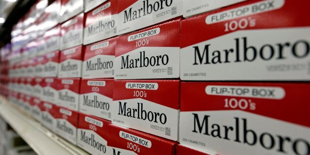 This June 14, 2018, file photo shows cartons of Marlboro cigarettes on the shelves at JR outlet in Burlington, N.C.