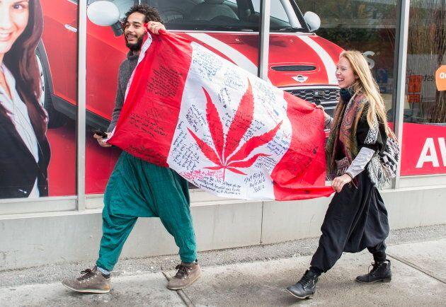 People celebrate cannabis legalization in Canada.