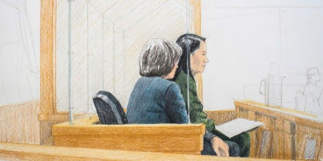 In this courtroom sketch, Meng Wanzhou, right, the chief financial officer of Huawei Technologies, sits...