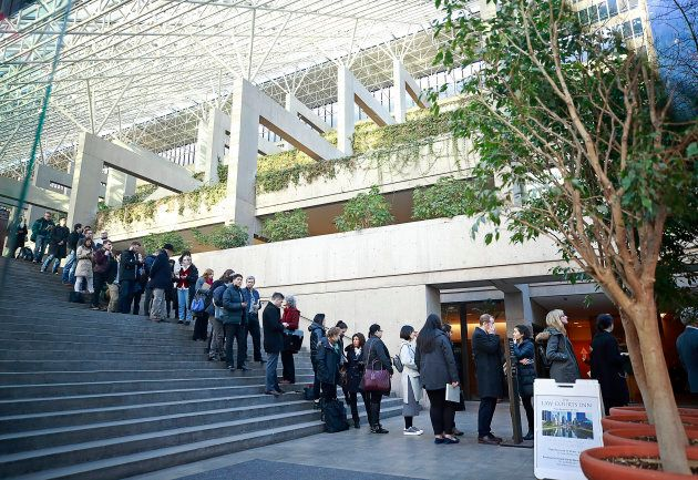 People wait in line to attend the bail hearing of Huawei Technologies Chief Financial Officer Meng Wanzhou...