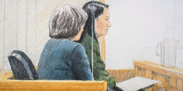 In this courtroom sketch, Meng Wanzhou (right), the chief financial officer of Huawei Technologies, sits...