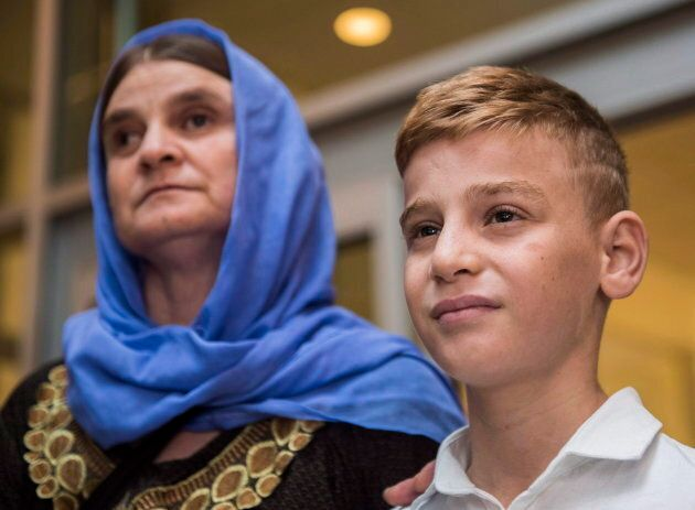 Nofa Mihlo Rafo, left, is reunited with her son Emad Mishko Tamo at Winnipeg's James Armstrong Richardson...
