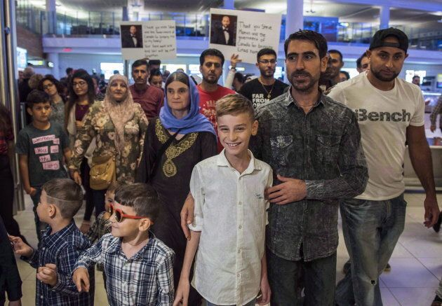 Emad Mishko Tamo, 12-year-old , centre, stands with uncle Hadji Tamo and his mother Nofa Mihlo Rafo as...