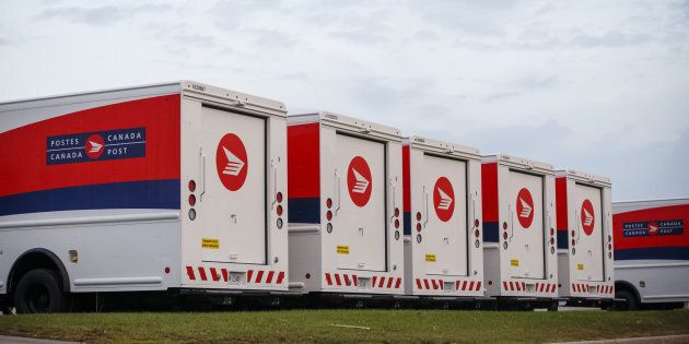 Canada Post trucks sit idle during the strike in Toronto, Ont. on Oct. 23,