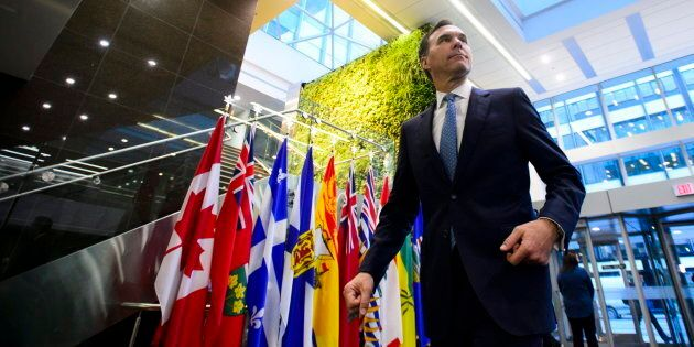 Finance Minister Bill Morneau makes his way to a meeting with his provincial and territorial counterparts...