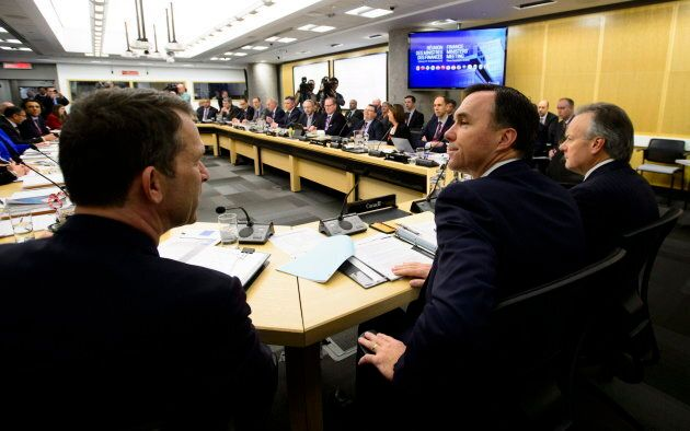 Finance Minister Bill Morneau, right, said Ontario's movement out of the equalization transfer program...