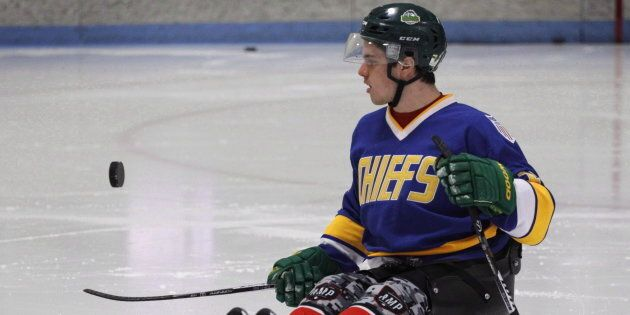 Humboldt Broncos hockey player Ryan Straschnitzki flips a puck before a sled hockey scrimmage at the...