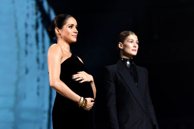 Meghan Markle and actress Rosamund Pike on stage during The Fashion Awards 2018 at Royal Albert Hall...