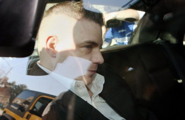 Michael Rafferty is transported in the back of police cruiser in London, Ont. on March, 14,
