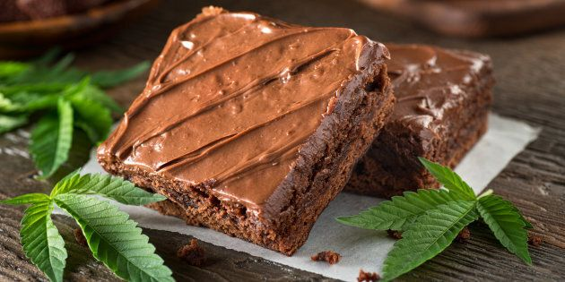 Homemade pot brownies with marijuana leaf garnish.