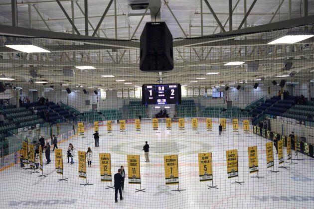 Sixteen banners in honour of the lives taken in the Humboldt Broncos bus crash in April are shown in the foreground and the banners for the survivors sit in the background during a tribute to the team in Humboldt , Sask., on Sept. 12, 2018.