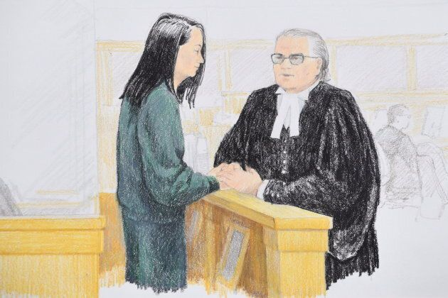 Meng Wanzhou speaks to her lawyer David Martin during a bail hearing at B.C. Supreme Court in Vancouver,...