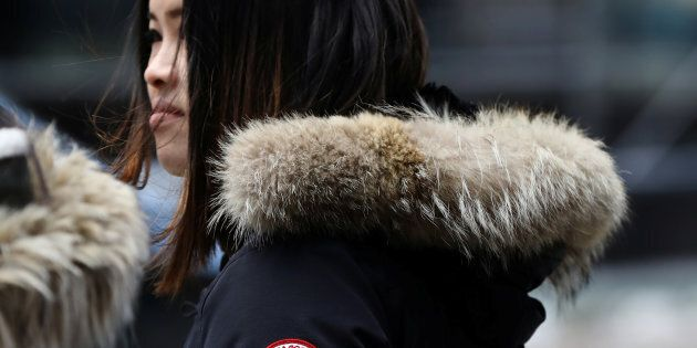 A woman wears a Canada Goose jacket in Times Square, New York, March 16, 2017. Canada Goose shares have...