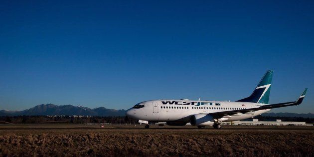 A Westjet Boeing 737-700 taxis to a gate at Vancouver International Airport in Richmond, B.C., on Feb....