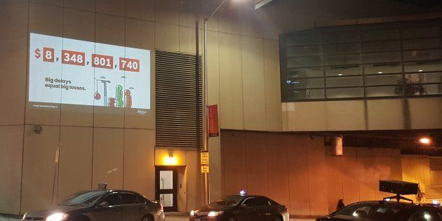 The Alberta NDP set up a projection for a pro-pipeline campaign outside a holiday event hosted by the...