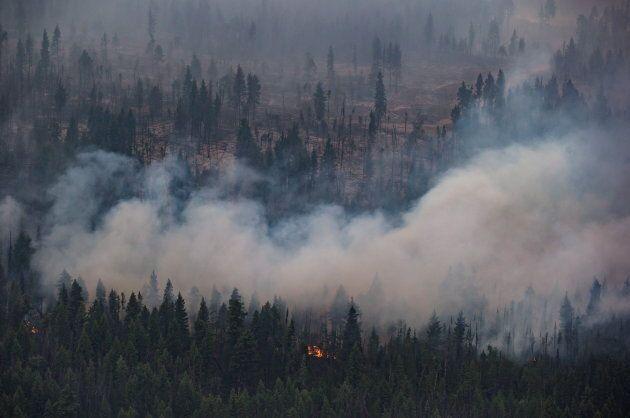 The Shovel Lake wildfire burns near the Nadleh Whut'en First Nation in Fort Fraser, B.C., on Aug. 23,