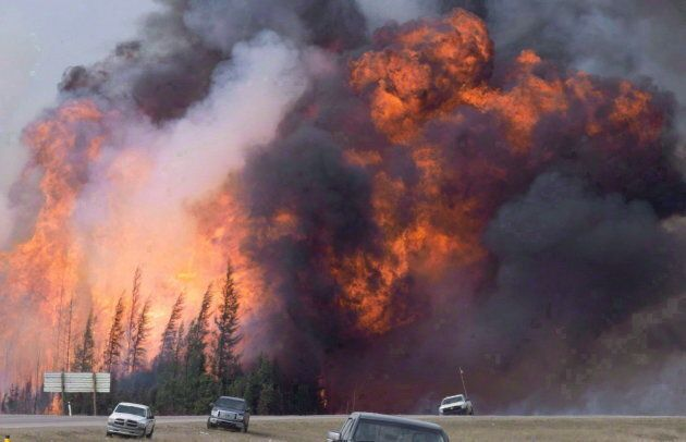 A wildfire rips through the forest by Highway 63, 16 kilometres south of Fort McMurray, Alta. on May...