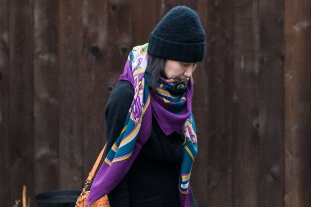 Meng Wanzhou, Huawei's chief financial officer, leaves her home under the supervision of security in...