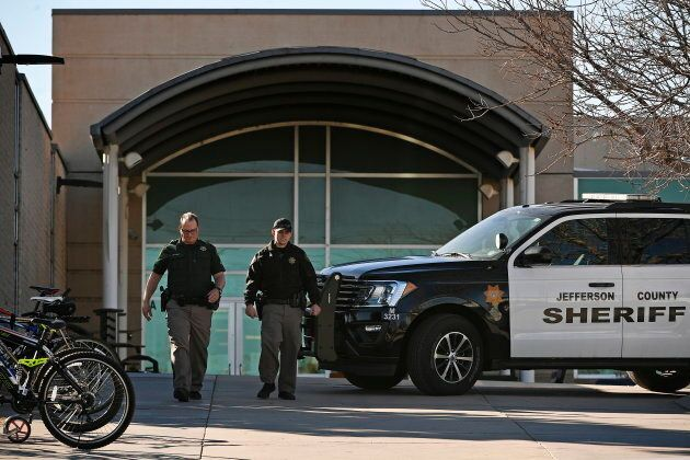 A member of the Jefferson County, Colo., Sheriffs Department stands guard outside the main driveway to...