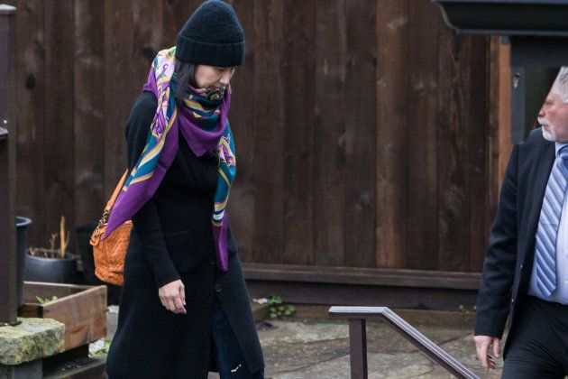 Meng Wanzhou, chief financial officer of Huawei Technologies Co., leaves her home under the supervision...