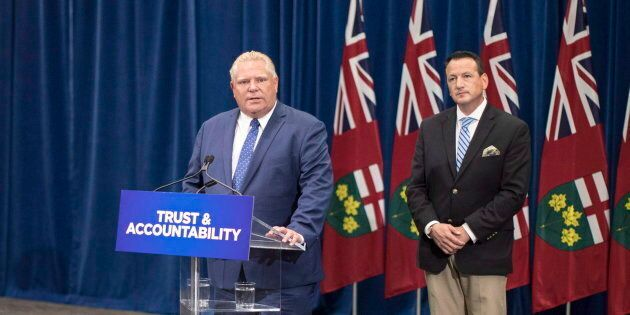 Ontario Premier Doug Ford stands with Minister of Energy Greg Rickford as he makes an announcement at...