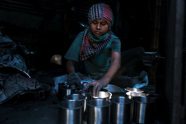 A child worker works in a utensil factory in Dhaka, Bangladesh on Nov. 25,