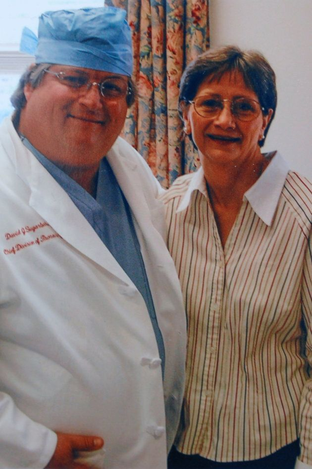 Darlene Coker is shown with her thoracic surgeon David Sugarbaker in this undated handout family photograph.