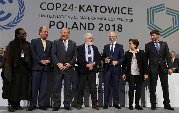 Heads of the delegations at the end of the final session of the COP24 summit on climate change in Katowice,...