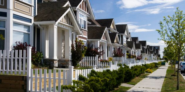 A row of townhouses in Richmond, B.C. Up to 71 percent of Canadians believe that the federal government should be doing more to curb runaway home values.