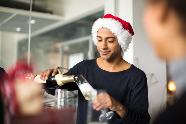 You too can host a party with all the coolness and confidence of this Santa hat-wearing man.