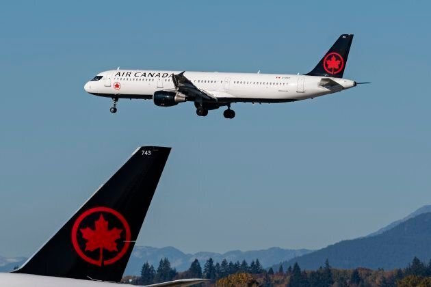 An Air Canada jetliner landing at Vancouver International Airport in Richmond, B.C. on Oct. 16,