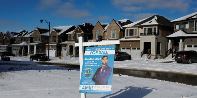 A house for sale in East Gwillimbury, Ont., Jan. 30. 2018. A new report from CIBC says the correction in Canada's housing market is not over yet —though it might finally come to an end next year.