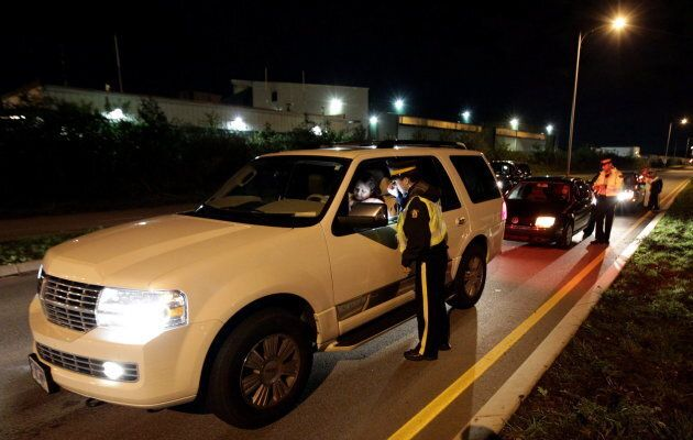 RCMP constables conduct roadside checks in Surrey, B.C., on Sept. 24,