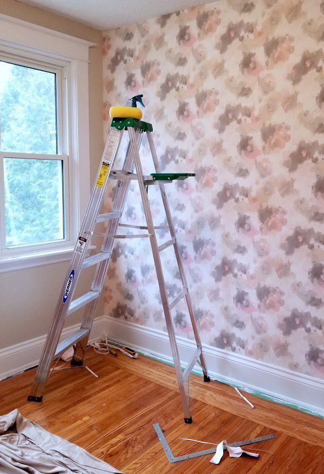 I turned a spare bedroom into a nursery — it was my first time hanging wallpaper.