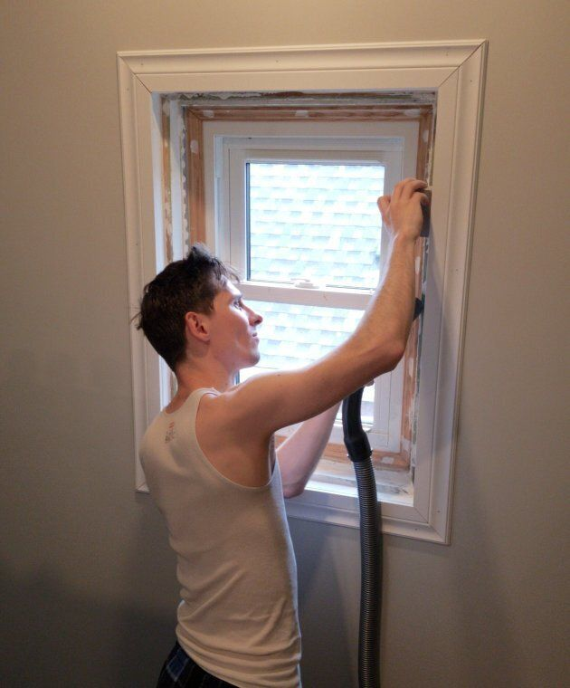 A most unflattering shot of me sanding the new window frames I built for the attic.