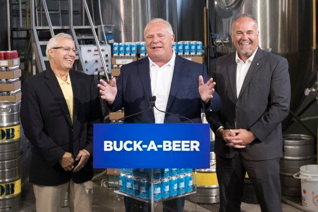 Ontario Premier Doug Ford announces his buck-a-beer policy with ministers Vic Fedeli and Todd Smith at...