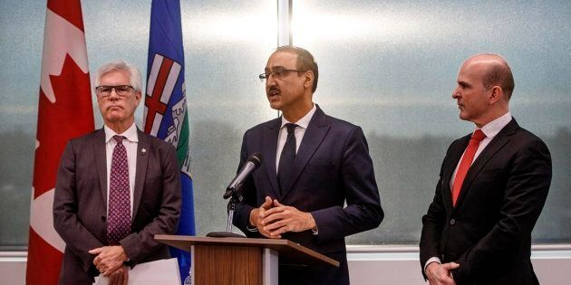 Minister of International Trade Diversification Jim Carr, left, Natural Resources Minister Amarjeet Sohi,...