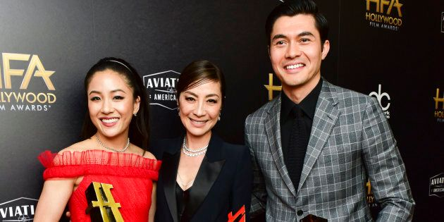 Constance Wu, Michelle Yeoh, and Henry Golding, recipients of the Hollywood Breakout Ensemble Award for 'Crazy Rich Asians,' pose at the 2018 Hollywood Film Awards, in Beverly Hills, California.