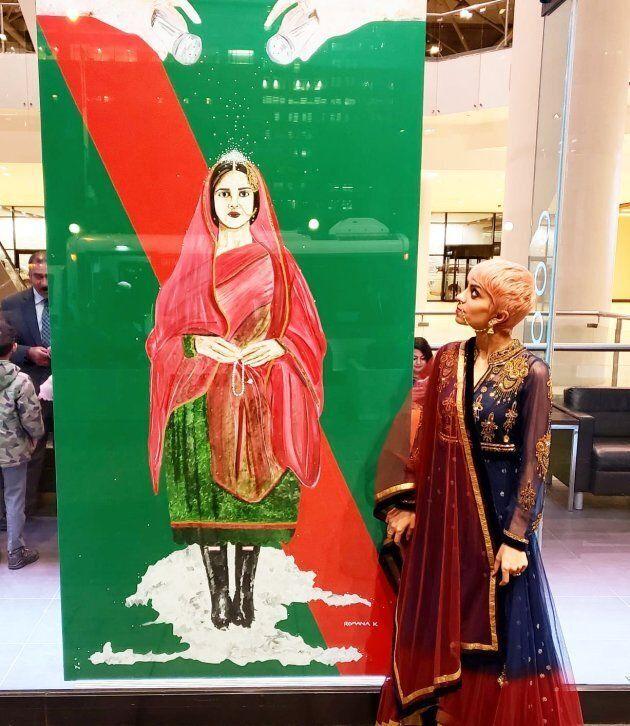 Romana Kassam standing next to her art work outside the Toronto Metro Convention Centre on Khushali on...