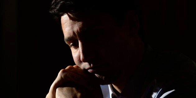 Prime Minister Justin Trudeau listens to a question as takes part in a year-end interview with The Canadian...