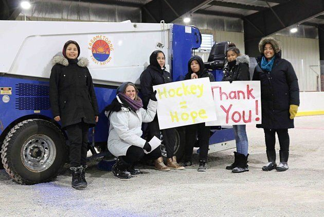 The Rez Girls share thank you signs with their GoFundMe