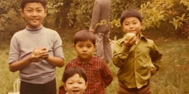 Saewan Koh, on the far right, with his three brothers apple picking in Mississauga,