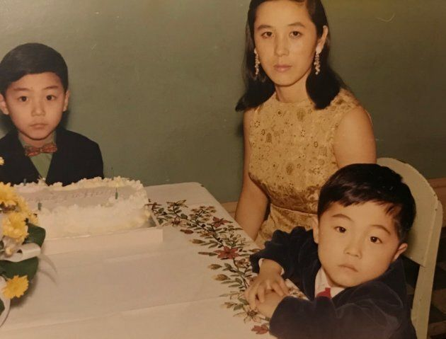 Three-year-old Koh (front, right) with his mother and brother in Vancouver in